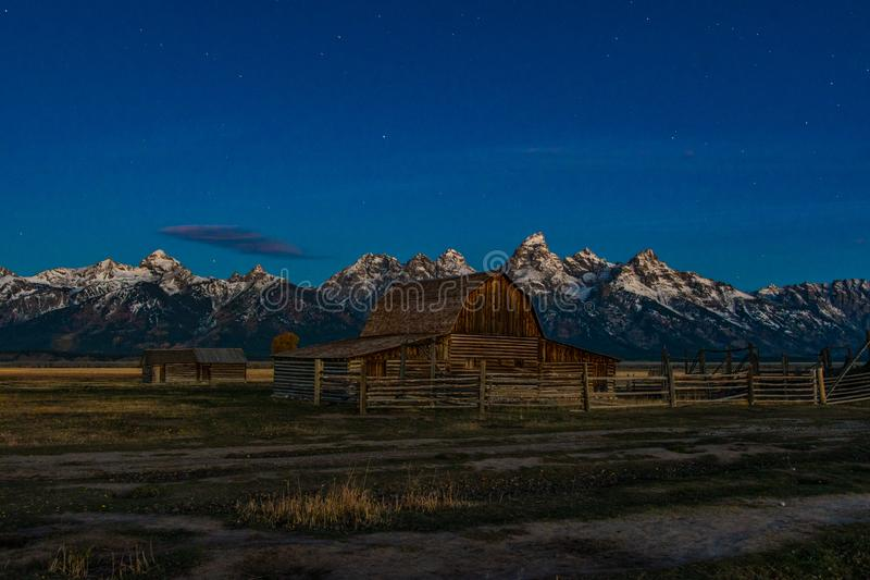 The Iconic Moulton Barn at Dawn. The Popular John Moulton Barn with the Tetons in the Background at Dawn stock images