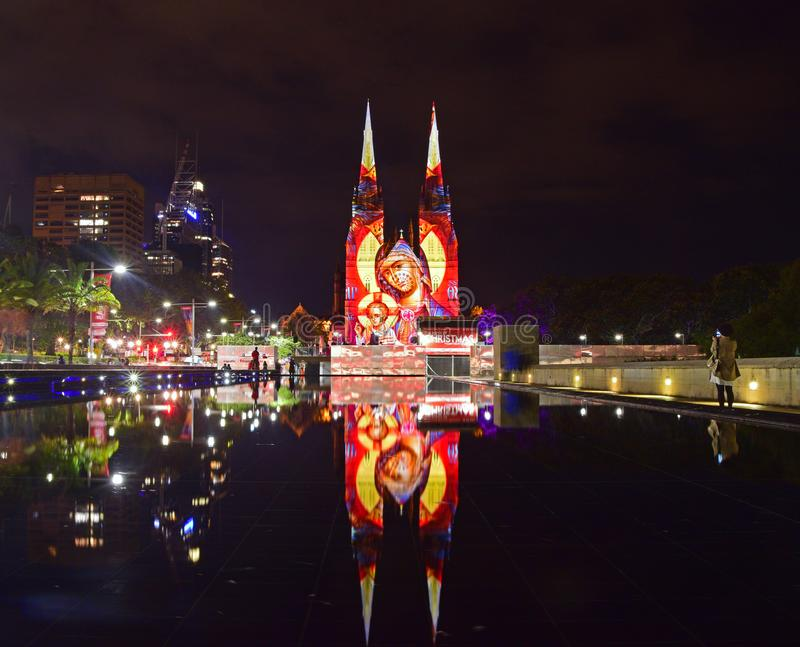 The popular Lights of Christmas at St Mary's Cathedral, Sydney. Lights of Christmas at St Mary's Cathedral, Sydney with fountain water reflection. This is an