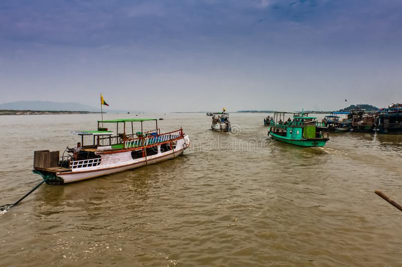 Tourist boats on the Irrawaddy River near Mandalay, Myanmar. A popular mode of transportation for Burmese people living near the Irrawaddy River royalty free stock photo