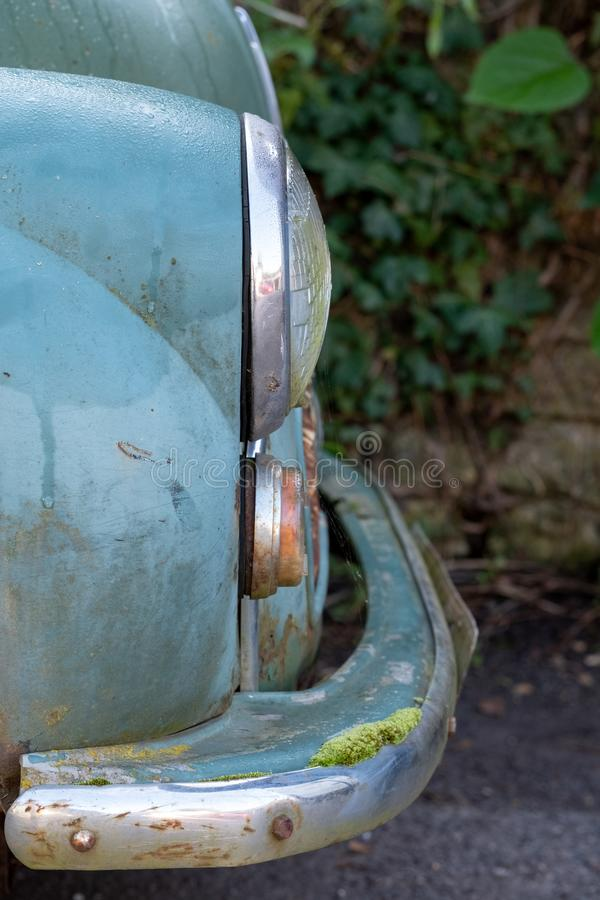 The popular Morris Minor 1000 vintage car. This car was also known as the `woody wagon` and is a British design icon. Close up of side of the once popular stock photo