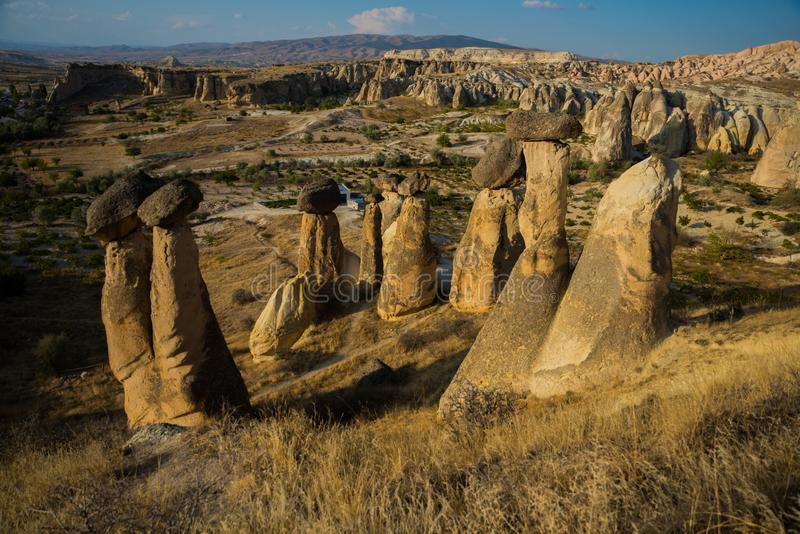 Popular rock form mushrooms. Beautiful landscape with unusual mountains. Fairy Chimneys, Pasabag, Monks Valley, Cappadocia, Turkey. Popular rock form mushrooms royalty free stock image