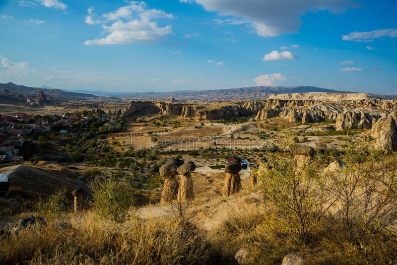 Popular rock form mushrooms. Beautiful landscape with unusual mountains. Fairy Chimneys, Pasabag, Monks Valley, Cappadocia, Turkey. Popular rock form mushrooms royalty free stock images