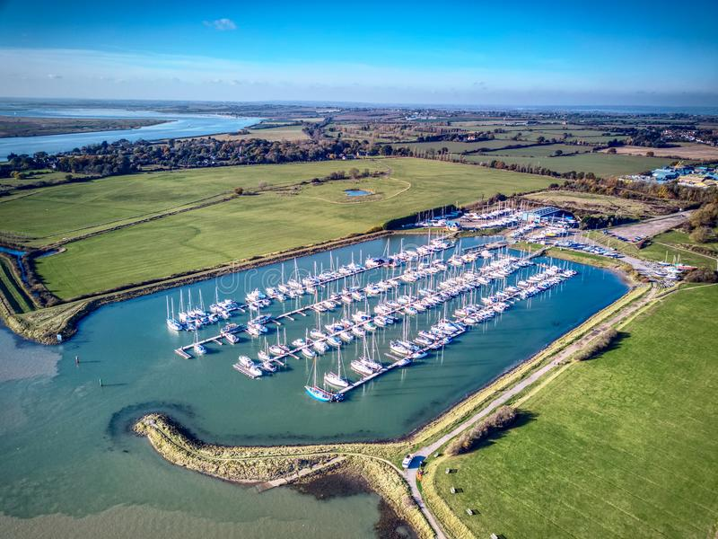 Burnham-on-Crouch river front - Essex. Popular Sailing town in Essex. Drone view of Essex Marina and Burnham Yacht Harbour In peek season the river is full of stock image