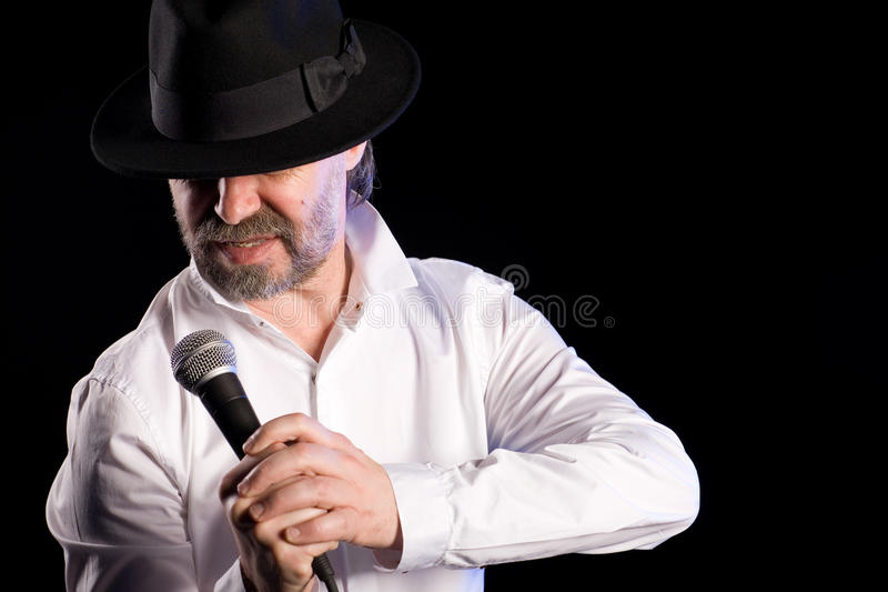 Popular singer with a microphone stock photos
