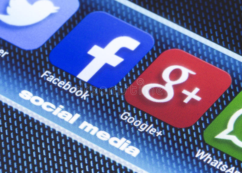 Popular social media icons facebook google plus and other on smart phone screen close up. BELGRADE - JULY 11, 2014 Popular social media icons facebook google royalty free stock images