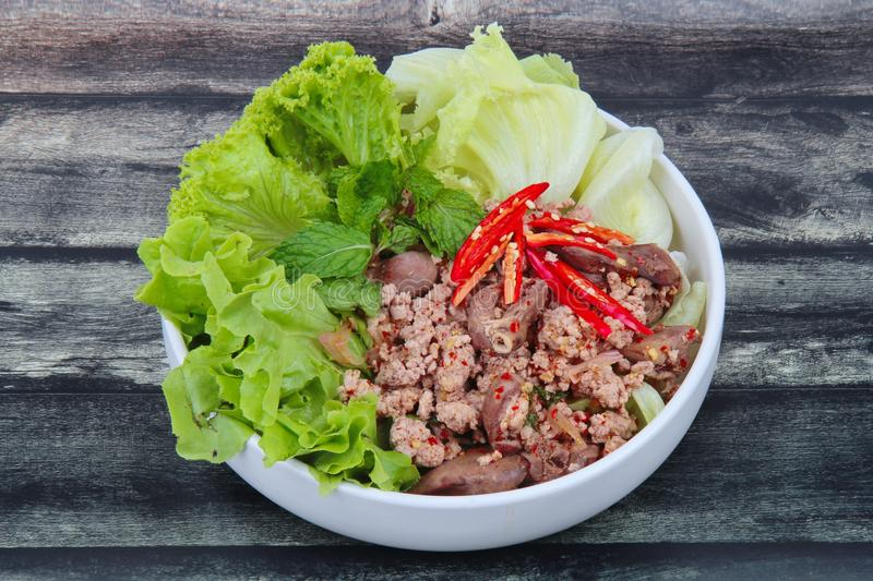 Spicy and sour mixed herb salad with minced pork and chicken. Popular Thai food ,Sliced grilled beef salad ,Spicy and sour mixed herb salad with minced pork and stock image