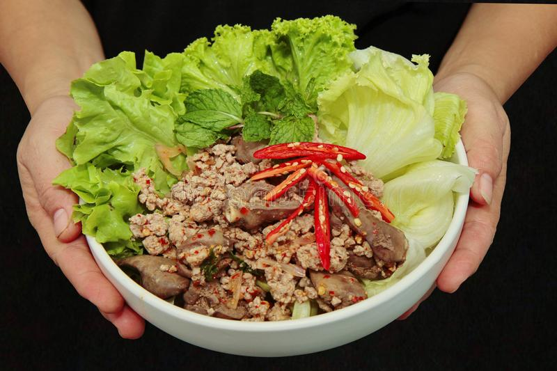 Spicy and sour mixed herb salad with minced pork and chicken. Popular Thai food ,Sliced grilled beef salad ,Spicy and sour mixed herb salad with minced pork and royalty free stock photography