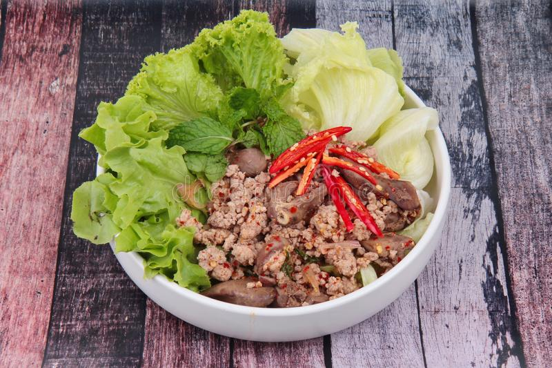 Spicy and sour mixed herb salad with minced pork and chicken. Popular Thai food ,Sliced grilled beef salad ,Spicy and sour mixed herb salad with minced pork and stock images