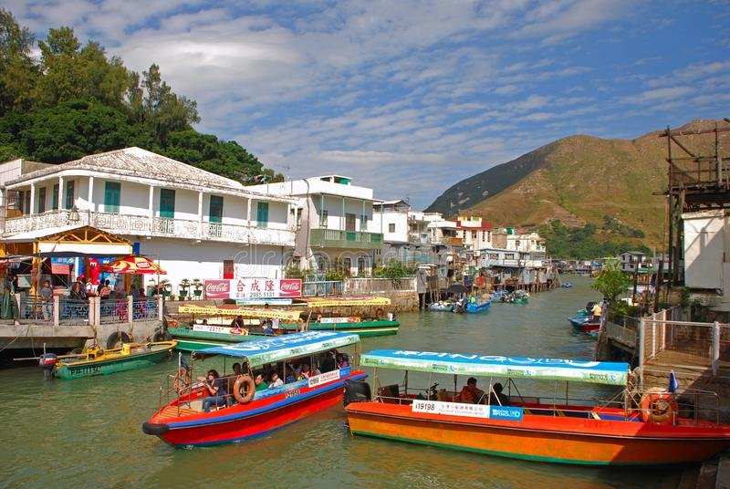 Popular Tourist Destination Tai O Fishing Village catering mass tourism in the engine powered boat royalty free stock photo