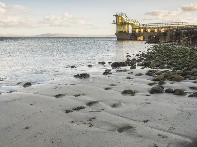 Popular tourists spot Black water diving tower, Salthill, Galway city, Ireland stock images