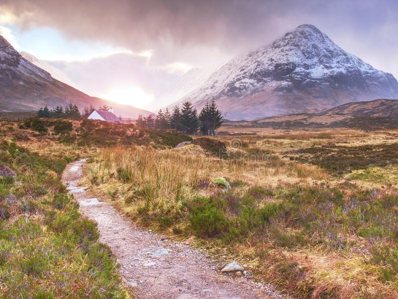 Popular trail at Coupall river, a valley in the Scottish Highlands stock photography
