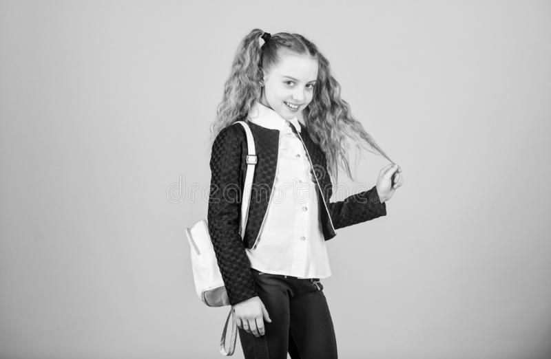 Popular useful fashion accessory. Schoolgirl with small leather backpack. Carry bag comfortable. Stylish mini backpack. Learn how fit backpack correctly. Girl stock photography