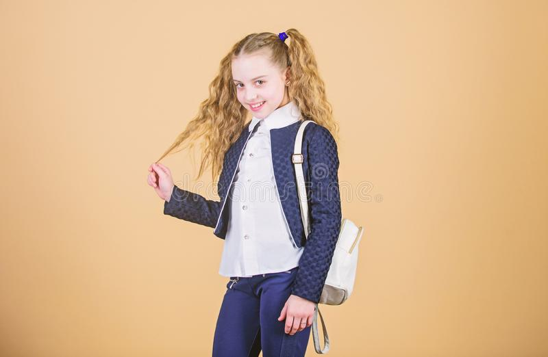 Popular useful fashion accessory. Schoolgirl with small leather backpack. Carry bag comfortable. Stylish mini backpack. Learn how fit backpack correctly. Girl royalty free stock images
