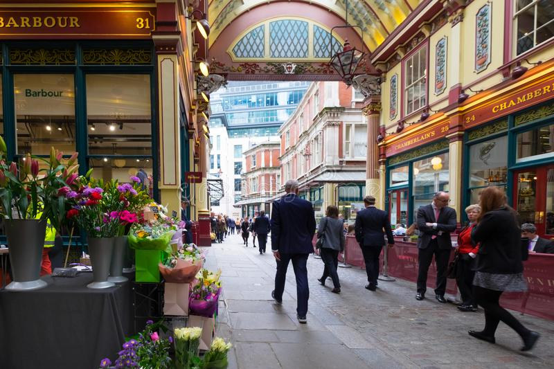 London, United Kingdom. April 23rd 2018. Leadenhall Market in the City of London, bustling with traders out for lunch. Popular victorian covered market royalty free stock image