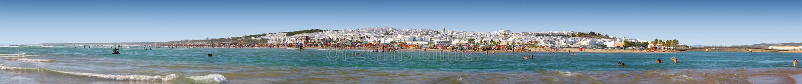 Beach panorama of conil de la frontera. Populated beach panorama of Conil de la Frontera on the Costa de la Luz, Andalusia Spain royalty free stock image