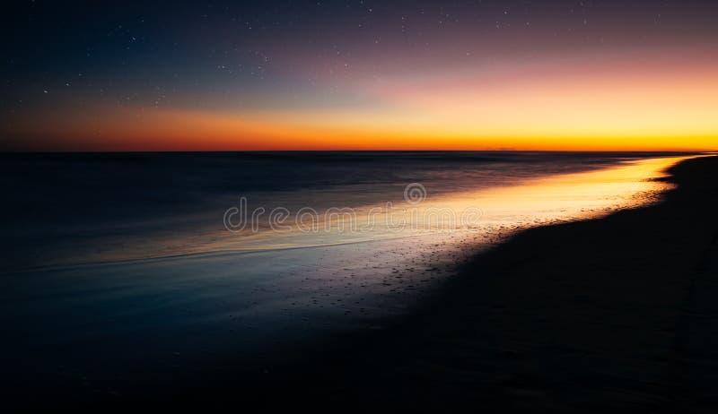 Por do sol com estrelas fotografia de stock royalty free