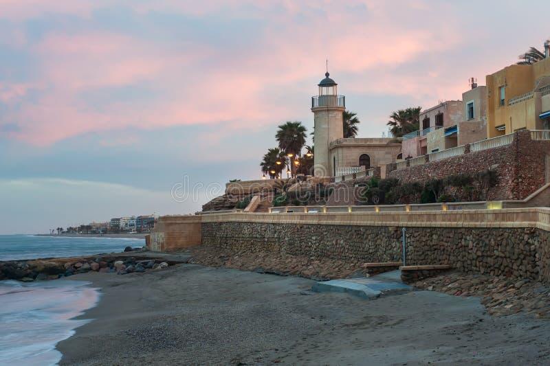 Por do sol da cidade com o mar fotografia de stock royalty free
