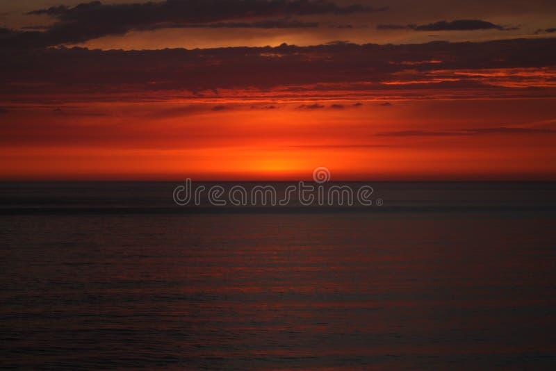 Por do sol da costa oeste foto de stock