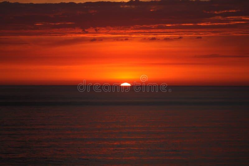 Por do sol da costa oeste imagem de stock