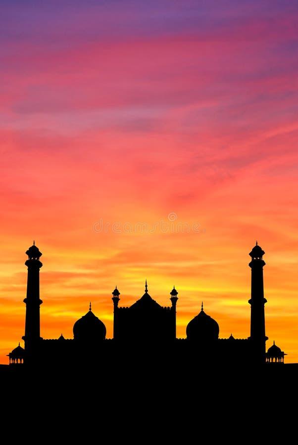 Por do sol da mesquita de Deli foto de stock