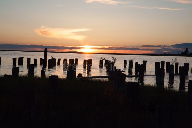 Por do sol da noite no oeste fotos de stock royalty free