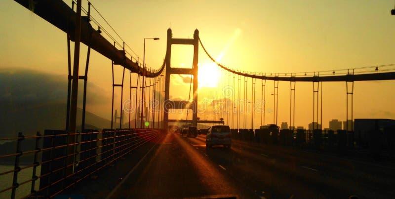 Por do sol da ponte de Tsing miliampère imagem de stock royalty free