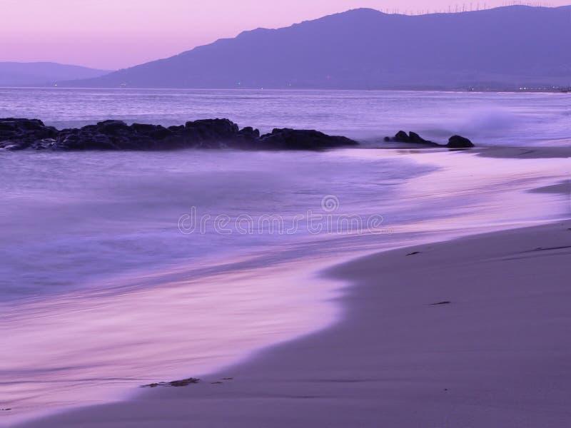Por do sol da praia de Gibraltar imagens de stock royalty free