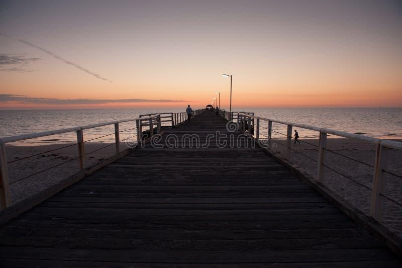 Por do sol da praia de Henley foto de stock royalty free