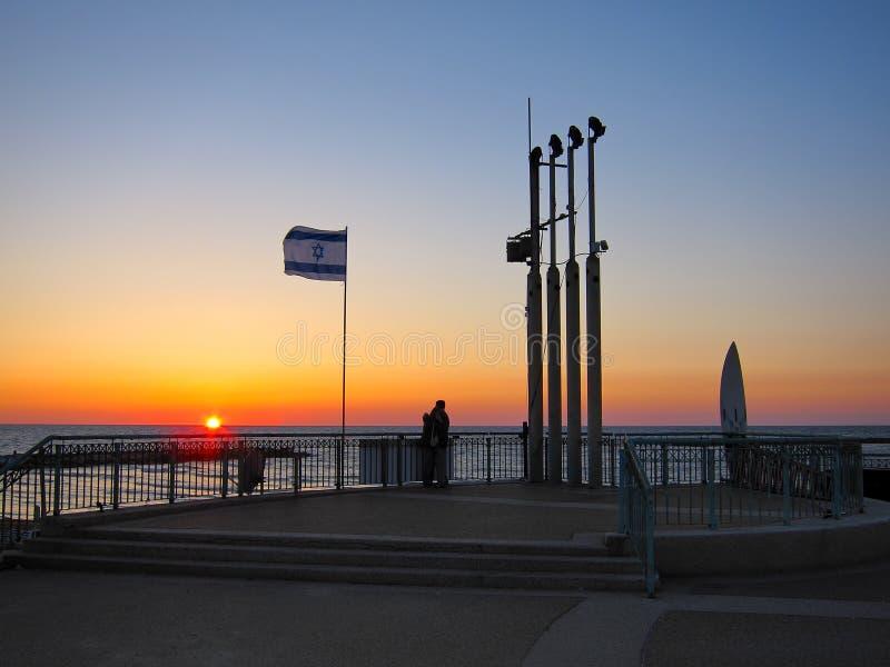 Por do sol da praia de Telavive, Israel imagem de stock