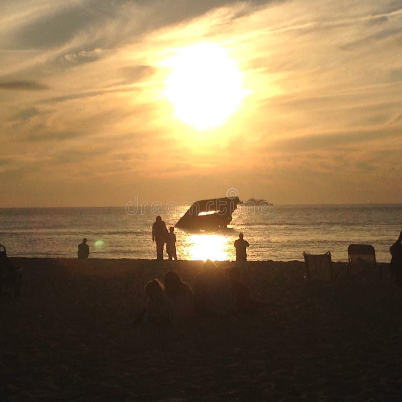 Por do sol da praia do por do sol fotos de stock royalty free