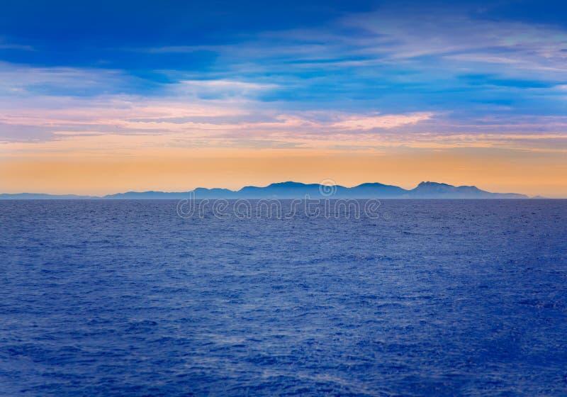 Por do sol de Ibiza na opinião de Balearic Island do mar fotografia de stock royalty free