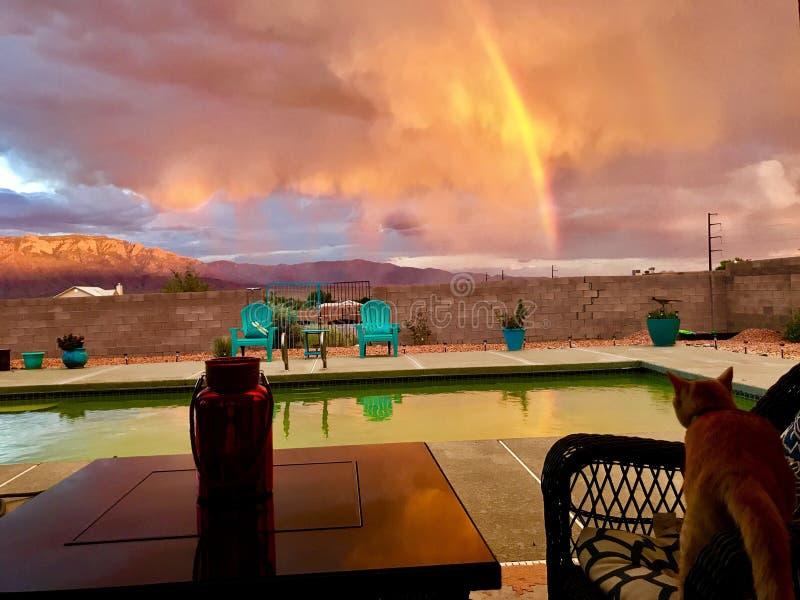 Por do sol de New mexico e arco-íris dourado fotos de stock royalty free