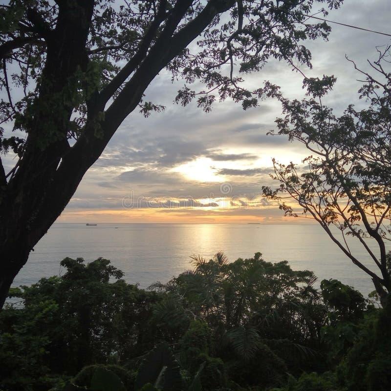 Por do sol de Teluk Bayur fotografia de stock