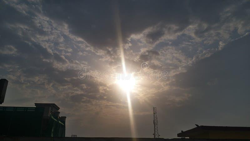 Por do sol de vilas indianas fotografia de stock