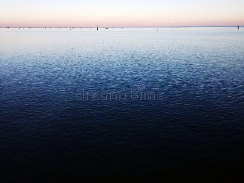 Por do sol desvanecido do oceano fotografia de stock royalty free