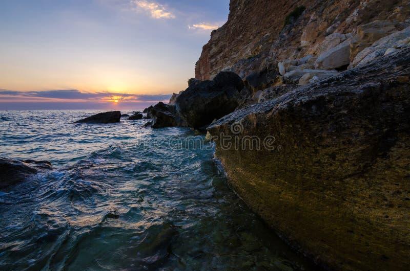 Por do sol Devon do beira-mar imagem de stock