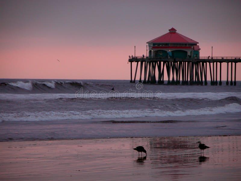 Por do sol do cais de Huntington Beach imagens de stock royalty free