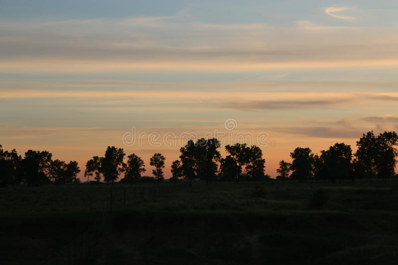 Por do sol do campo imagem de stock royalty free