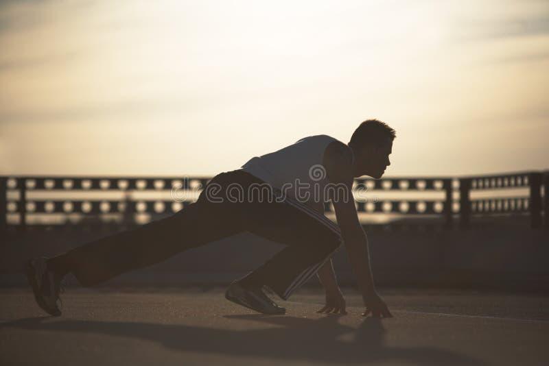 Por do sol do desportista fotos de stock