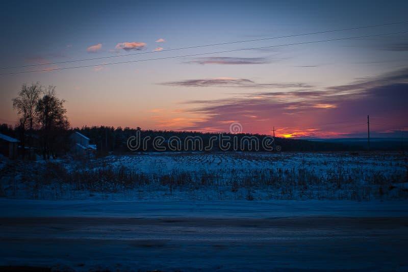 Por do sol do inverno foto de stock royalty free