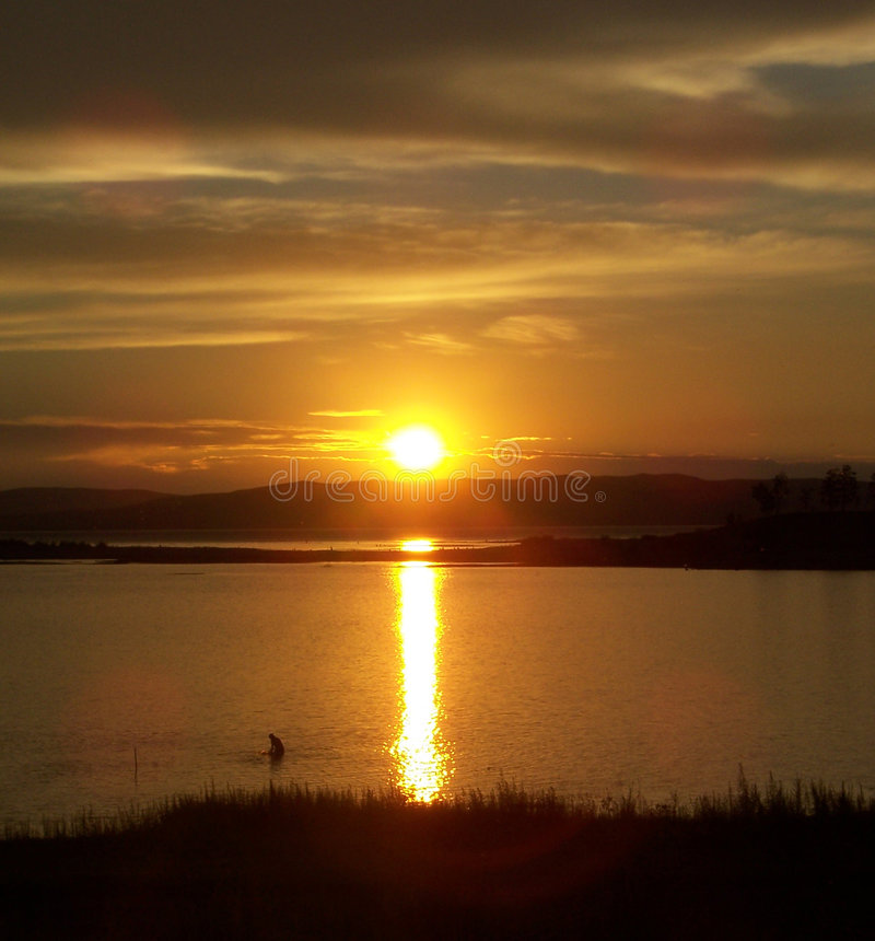 Por do sol do lago foto de stock