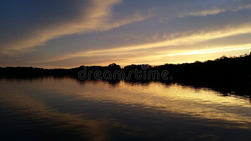 Por do sol do lago rock imagens de stock