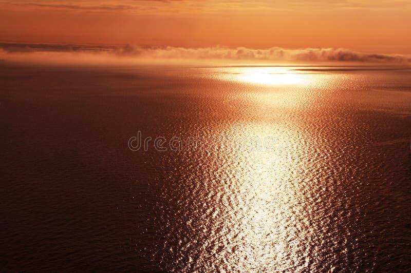 Por do sol do mar imagens de stock royalty free