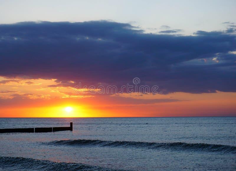 Por do sol do mar foto de stock