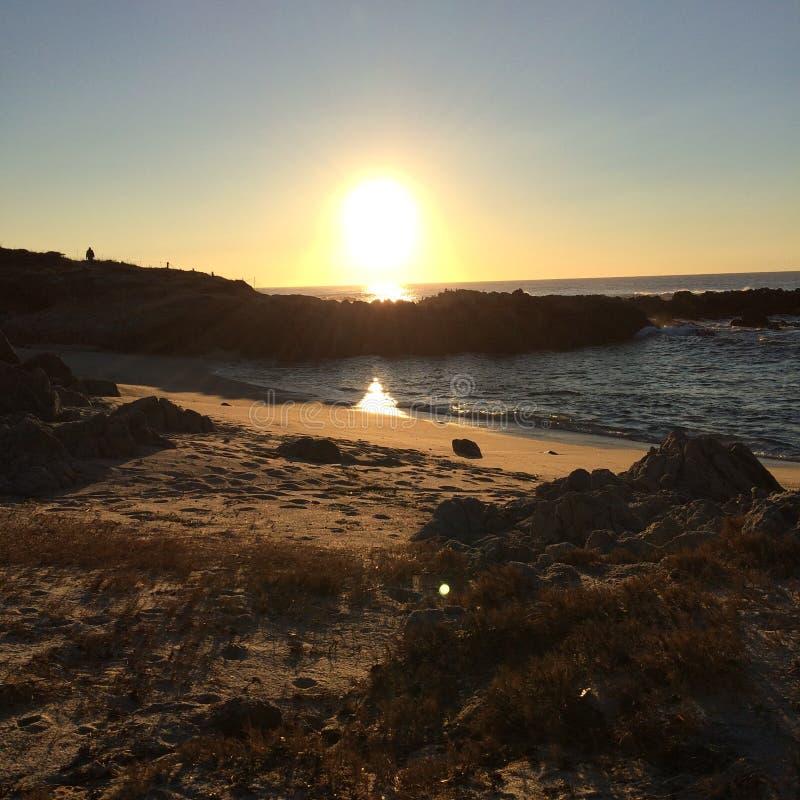 Por do sol do oceano da praia de Asilomar imagens de stock