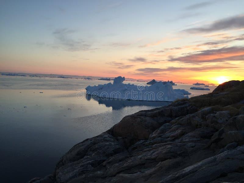 Por do sol em Gronelândia ártico imagens de stock
