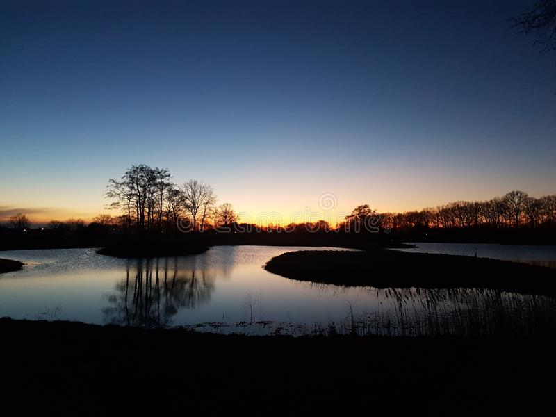 Por do sol Golfcourse fotos de stock royalty free