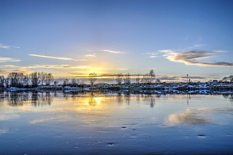Por do sol lento do rio fotografia de stock