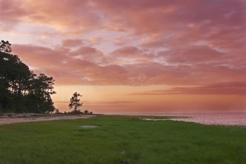 Por do sol litoral imagem de stock royalty free