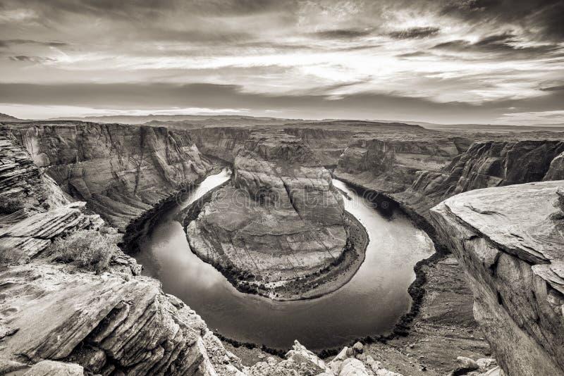 Por do sol na curvatura em ferradura - Grand Canyon com o Rio Colorado - situada na página, o Arizona, EUA fotos de stock royalty free
